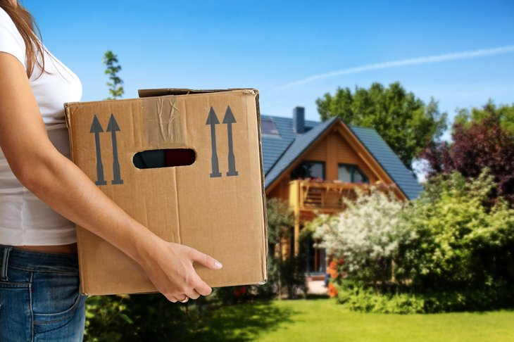Woman packing boxes for a home move