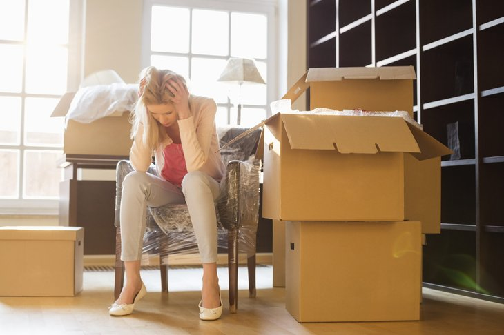 Frustrated woman packing at home