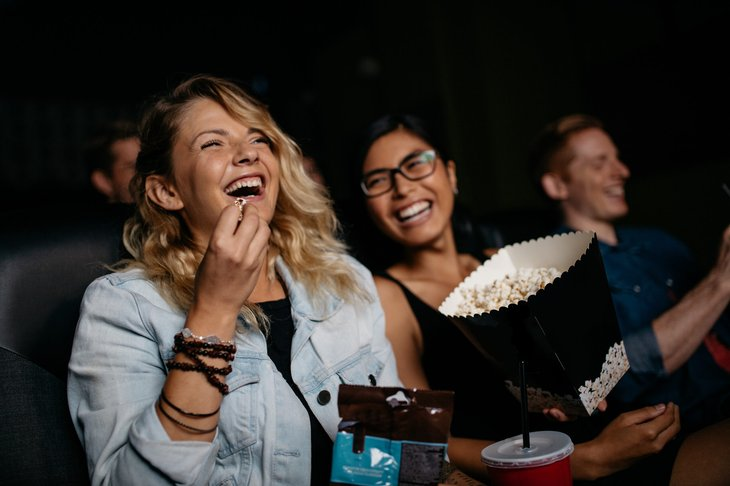 Two women watching a movie