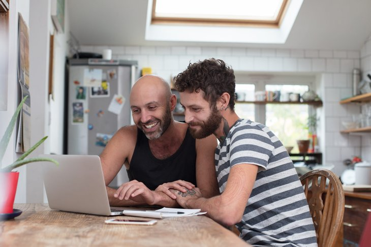 Gay couple using a laptop