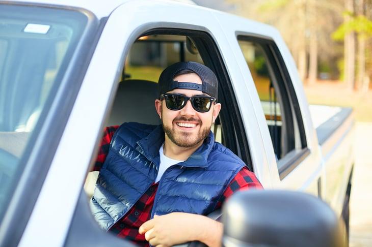 Man driving a pickup truck