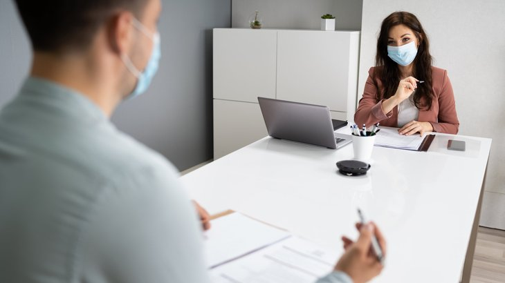 People in masks at a job interview during the coronavirus pandemic