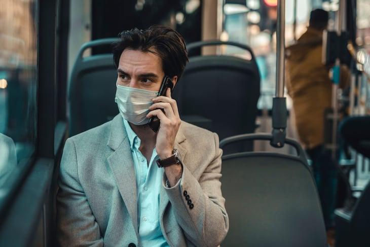 Man wearing a mask on public transportation