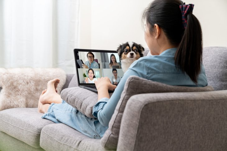 Woman in video meeting from home