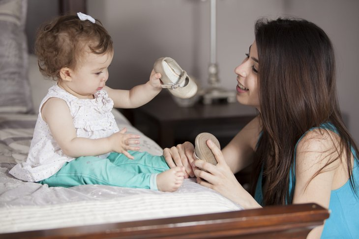 Baby and mom with shoes