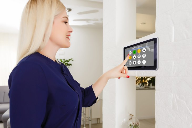 Woman using a smart home control system