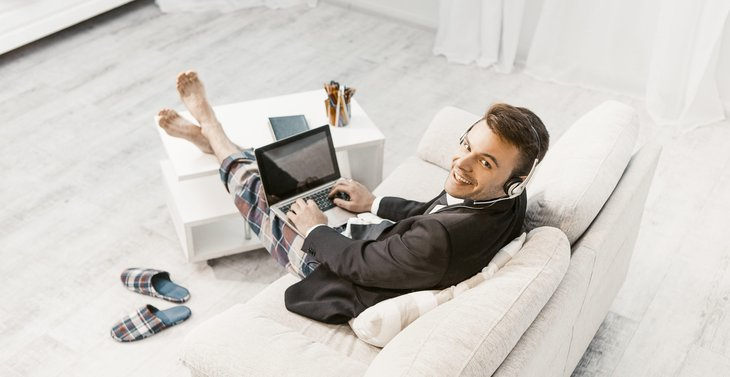 Businessman working from home in a suit and pajama pants