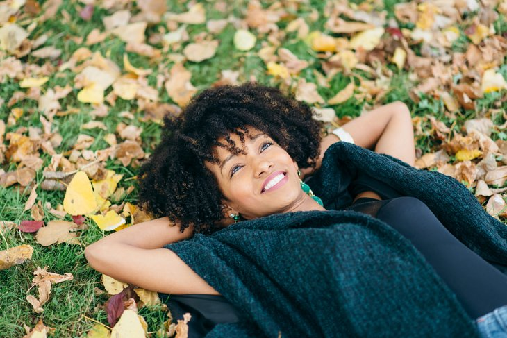 Woman relaxing on a fall day