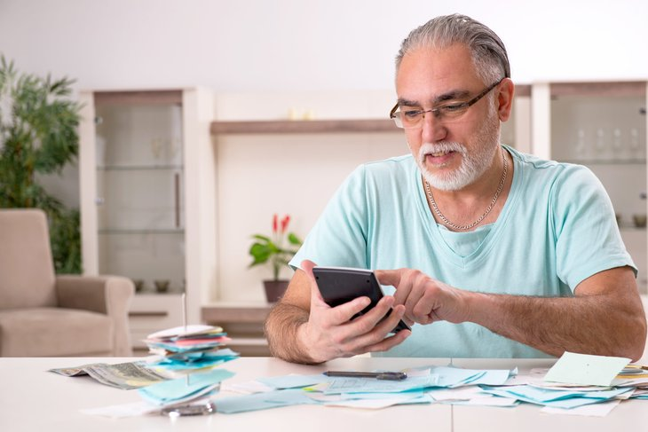 Stressed retiree doing budgeting and paying bills