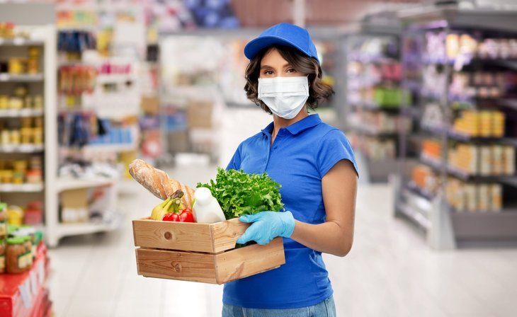 Grocery worker in a mask