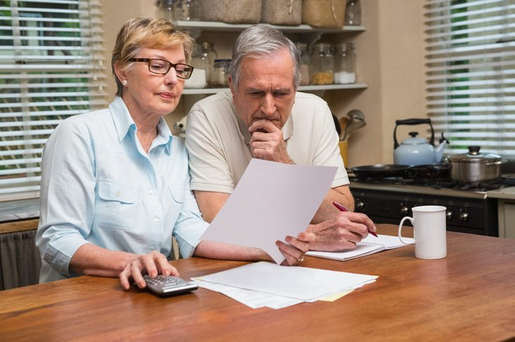 Senior couple doing retirement planning and math