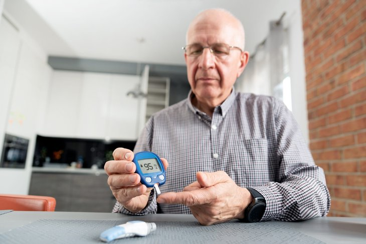 Diabetic senior checking his blood sugar