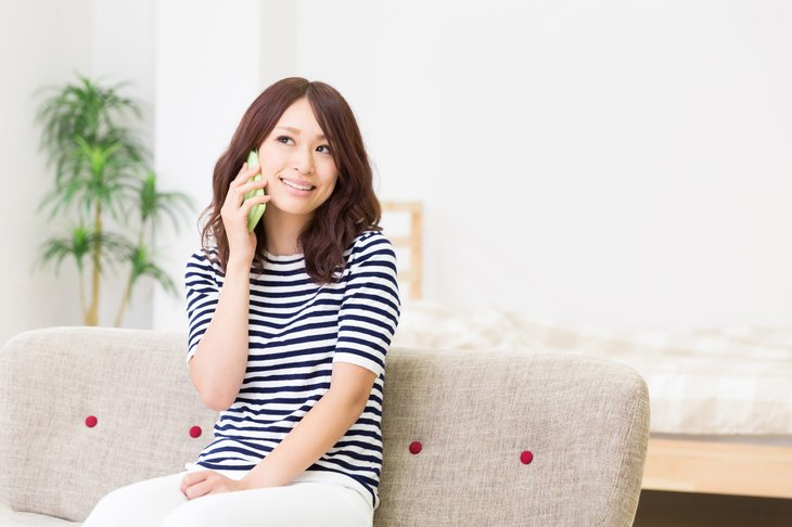 Asian woman talking on her smartphone