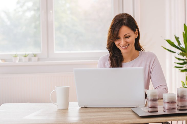Businesswoman working remotely on laptop at home