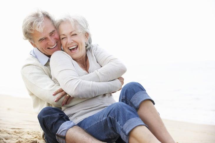 Happy senior couple at the beach