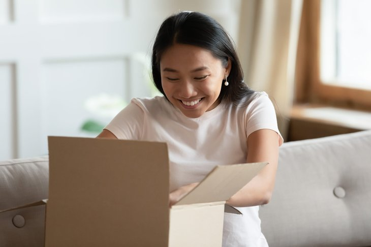 Woman opening a package