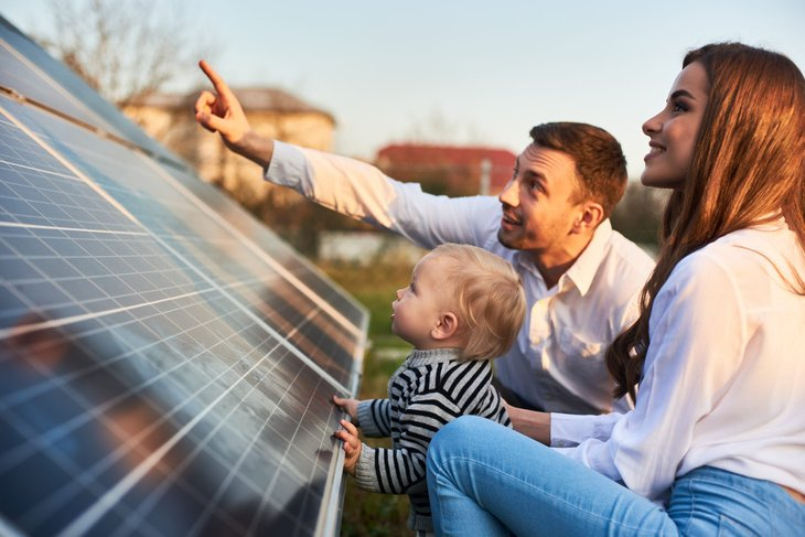 Family looking at solar panels for home solar energy