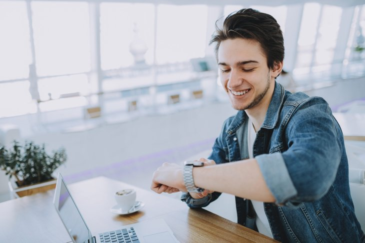 Young remote worker happy about his time saved commuting