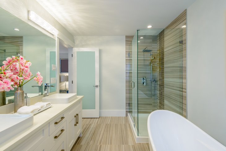 Upscale bathroom with tub and shower