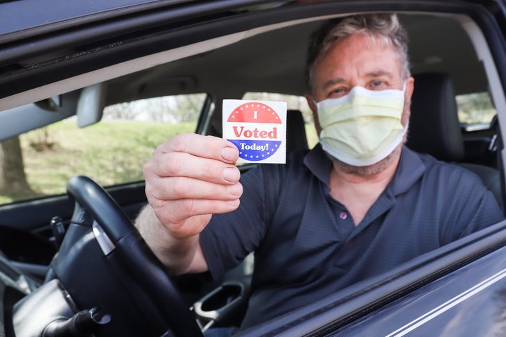 Man in a face mask after voting
