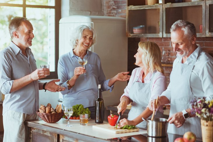 Baby boomer friends in a kitchen