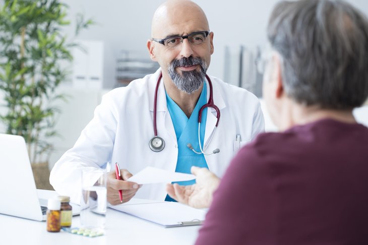 Male doctor talks to the patient