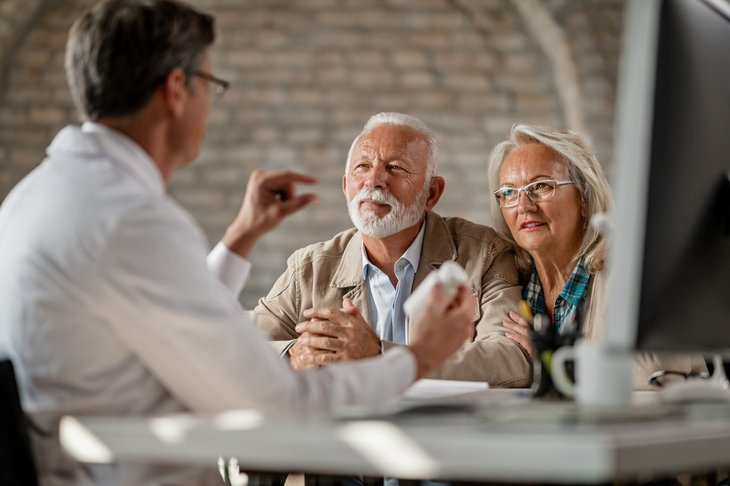 Doctor counseling Medicare beneficiaries during open enrollment