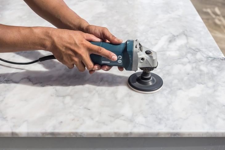 Hand polishing marble
