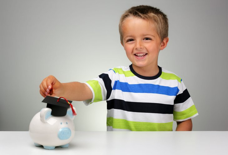Young boy saving for college