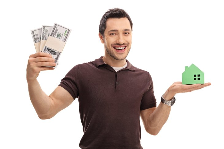 Happy man with money and a house