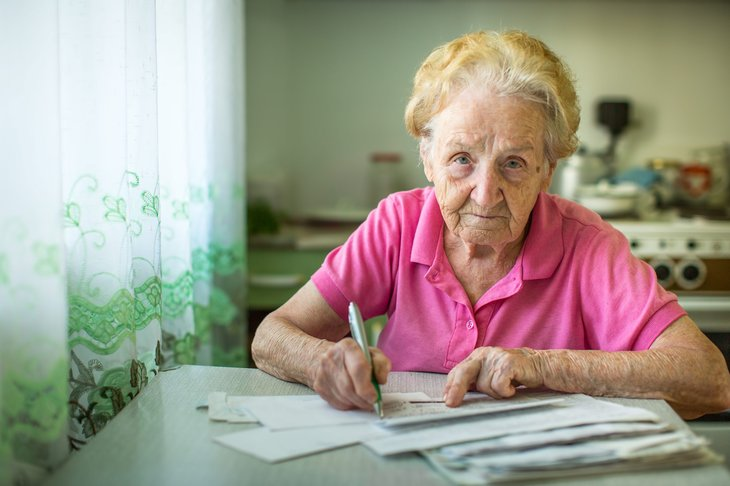Senior woman paying Medicare bills