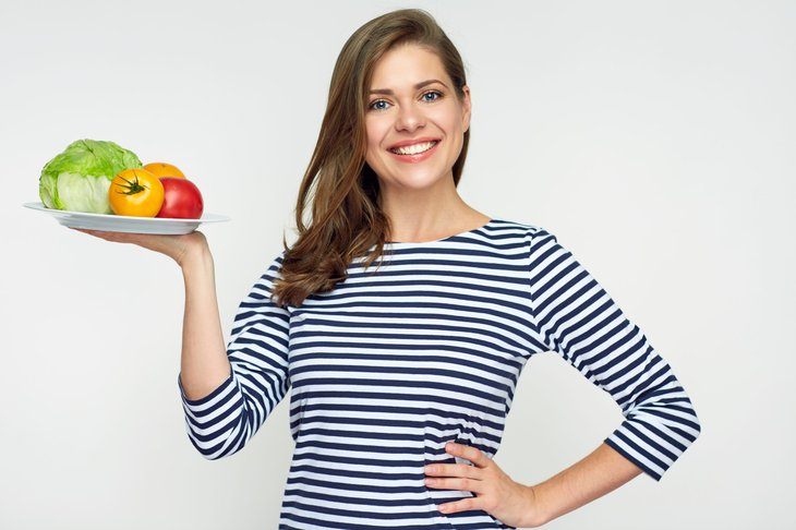 Woman with healthful food