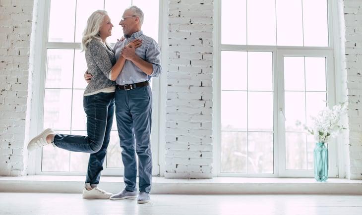 Senior couple happily dancing