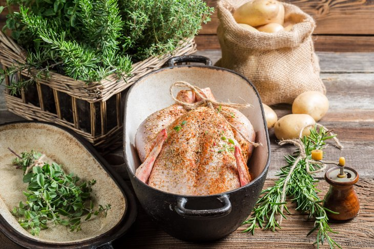 Chicken and herbs tied with cooking twine