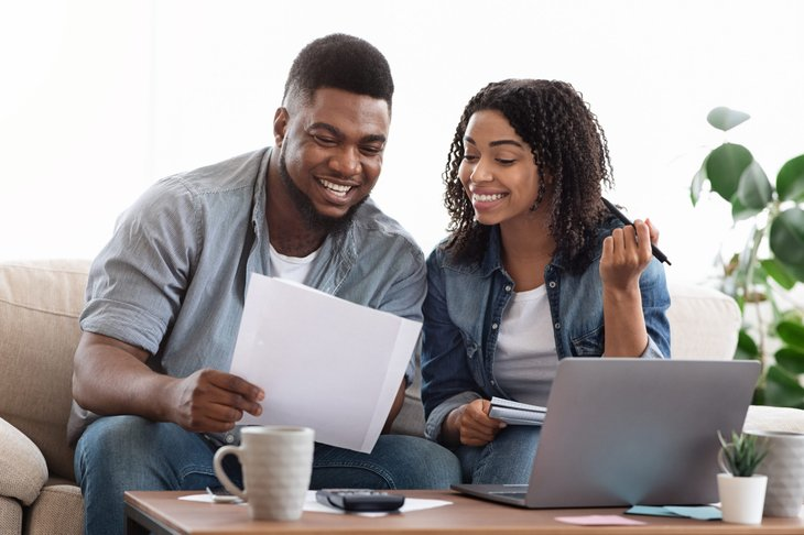 Young couple reviewing year-end tax documents
