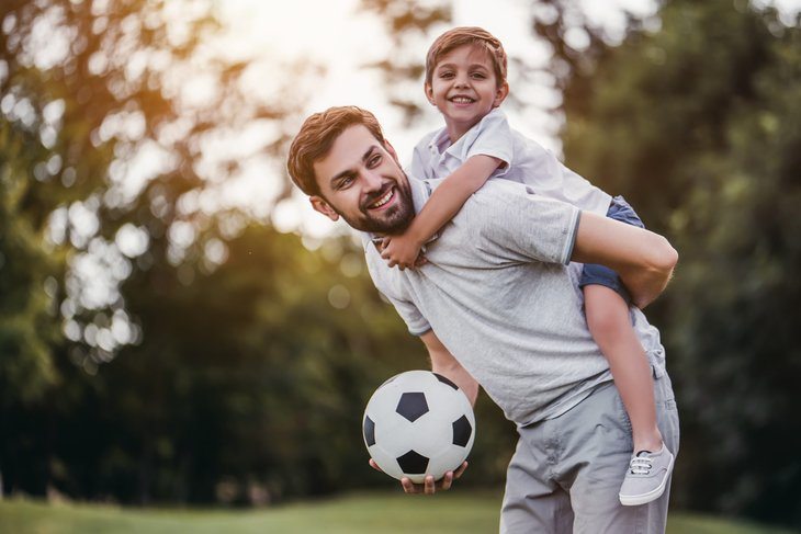Father and son in the park with a soccer ball