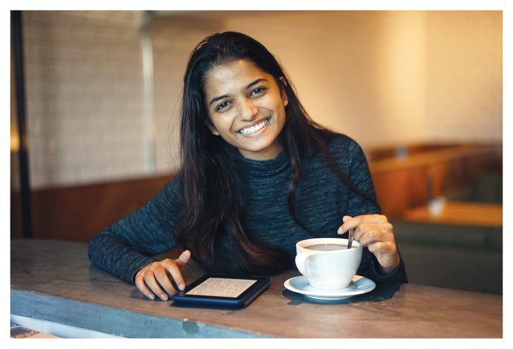 Woman with e-reader and coffee