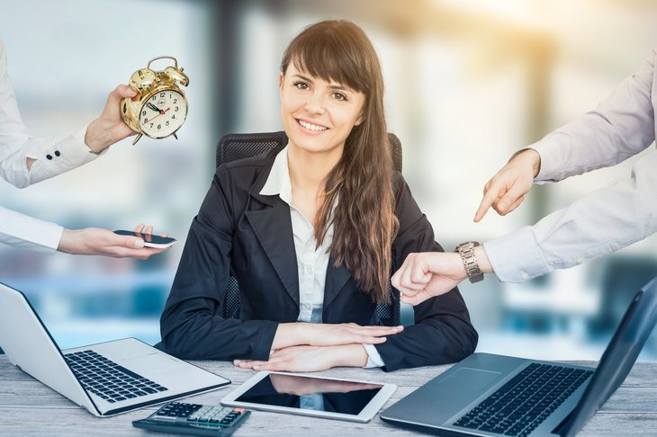 Stress free woman with computer and many obligations