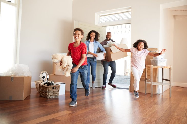 Happy family moving into new home