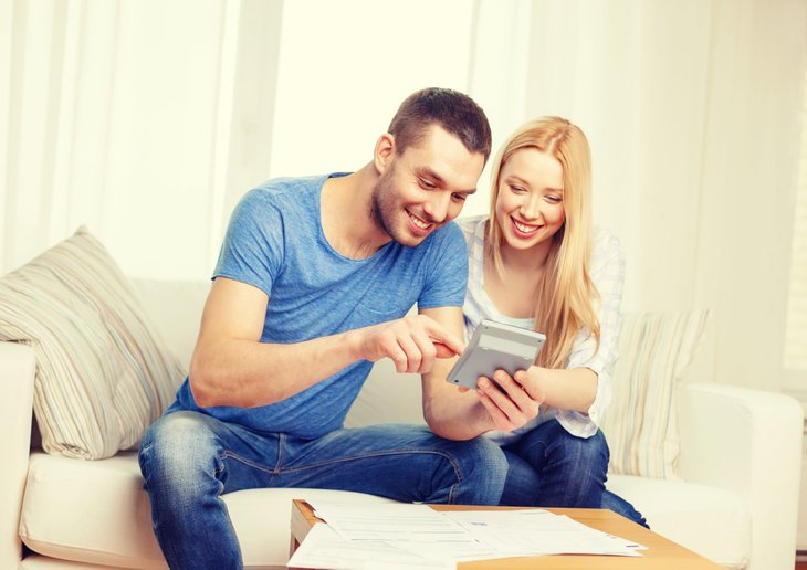 Happy couple with mortgage calculator