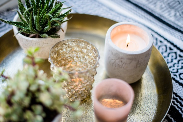 Candles next to a houseplant