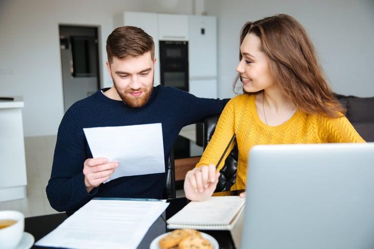 Happy couple taxes bills