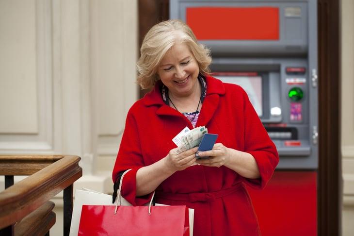 Senior bank customer at an ATM