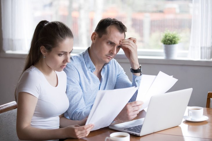 Stressed couple planning taxes and finances