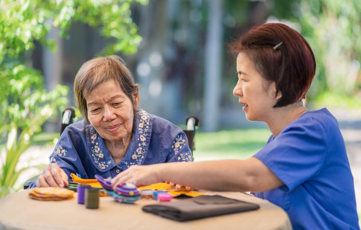 Senior with dementia doing occupational therapy