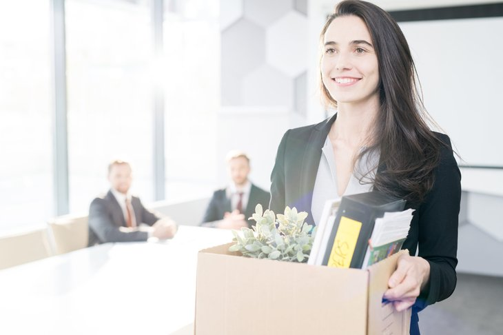 Young woman giving up job