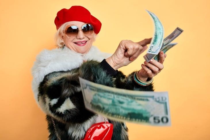 senior woman lots of money happy retirement