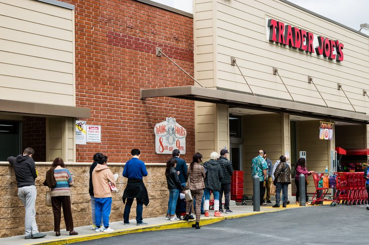 Shoppers wait in line outside a Trader Joe's store during the coronavirus pandemic