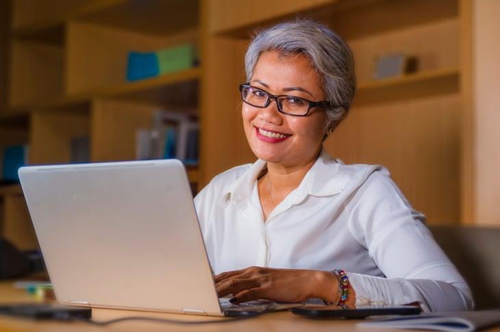 Woman investing at computer