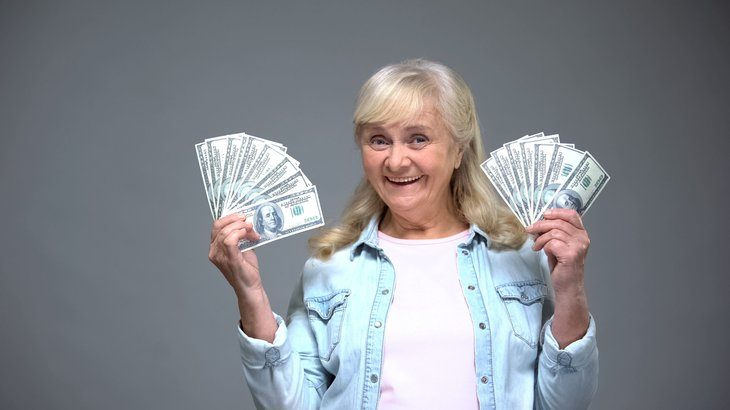 retiree senior woman holding money